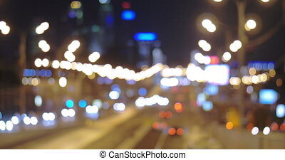 Road Traffic in Big City - Defocused shot of road traffic in...