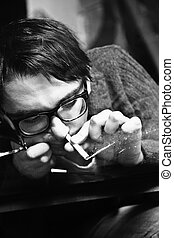 young man in glasses inhaling drugs - young man in...