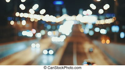 Everyday Car Traffic in City - High-angle defocused shot of...