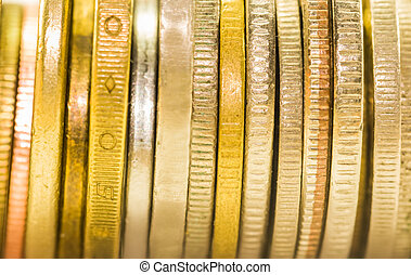 selective focus golden coins and coins stacked on each other...