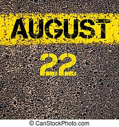 22 August calendar day over road marking yellow paint line -...