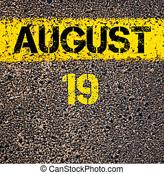 19 August calendar day over road marking yellow paint line