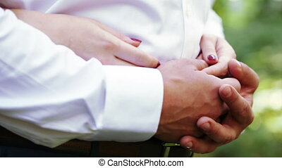 Hands newlywed nature - Bride and groom walking in park