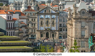 View of the Almeida Garret Square with the Sao Bento railway station and Congregados Church at the back timelapse.