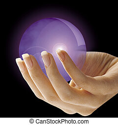 Crystal ball - Woman\'s hand holding a crystal ball