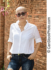 portrait of self confidence hairless woman standing outdoor