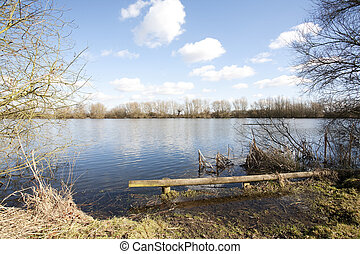 lakeside log - lake side view on a sunny winters day
