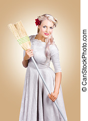 Old fashion woman spring cleaning with broom - Vintage woman...