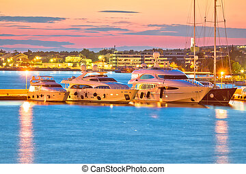 Luxury yachts at Zadar harbor evening view, Dalmatia,...
