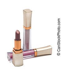lipstick and lip gloss - Open lipstick and lip gloss on a...