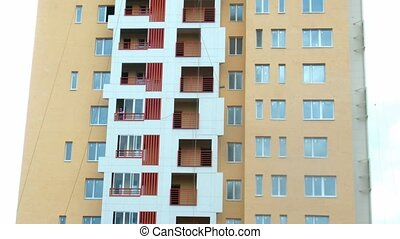 House building: installation of glasses on balconies