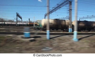 train tracks and cisterns from moving train