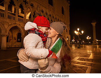 Mother and child with Italian flag on Piazza San Marco in...