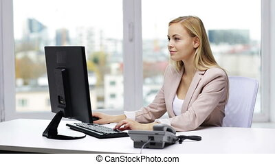 smiling businesswoman with computer and telephone -...