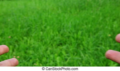 stretch hands on green grass background