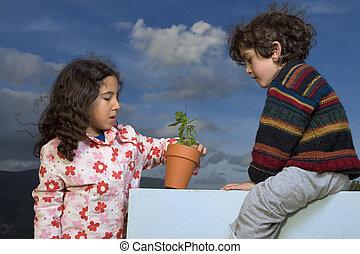 two kids plant pot