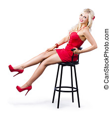 Pinup girl relaxing on a bar stool - Glamorous blond pinup...