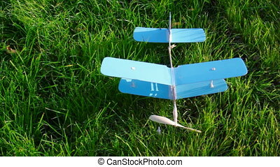 toy aircraft on green grass