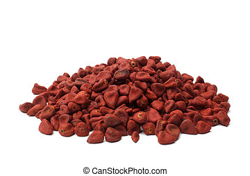 Annatto seeds on white background
