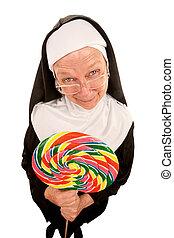 Funny nun with lollipop