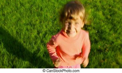 little girl running after camera