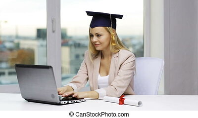 student in bachelor cap with laptop and diploma - education,...