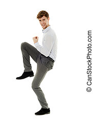Cheerful young businessman celebrating success, full body on...