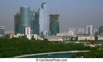 driving past moscow city skyscrapers