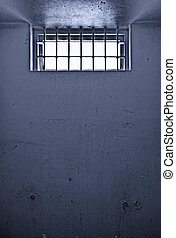 old prison cell with barred window - old dirty prison cell...