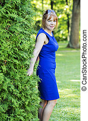 Adult woman poses in the green park - Attractive female...