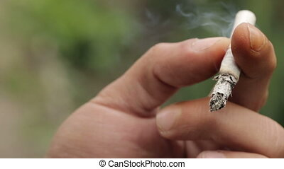 Cigarette in the Hands of a Smoker - Smoking Addiction,...