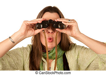 Woman using binoculars - Woman using vintage binoculars with...