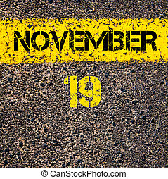 19 November calendar day over road marking yellow paint line