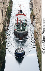 Corinth Canal - Tug conducting ship through the Corinth...