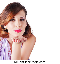 Woman blowing kiss - Attractive young woman with auburn hair...