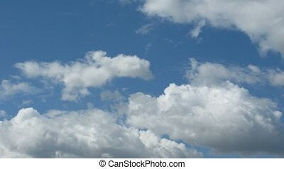 Clouds float on blue sky