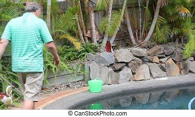 A Man Salts Swimming Pool