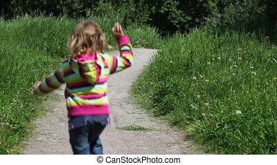 Little girl running by country road