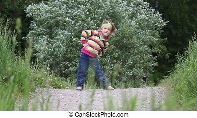 Little girl doing physical training exercises