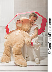 Girl playing with teddy bear - Lovely expressive little girl...