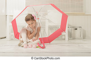Little girl playing tea party - Lovely little girl playing...
