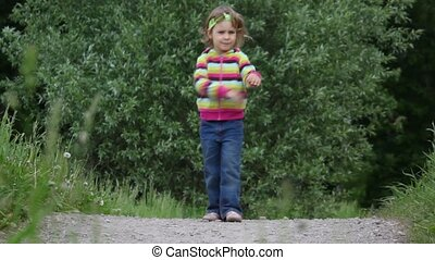 Little girl dancing on the road