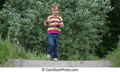 Little girl running on the spot