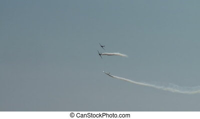 Aerobatics. View of planes performing turn in air -...