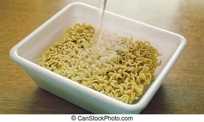 Noodles of fast preparation are filled in with boiled water