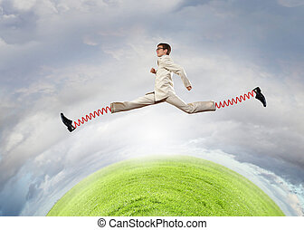 Businessman making wide jump - Businessman in suit jumping...