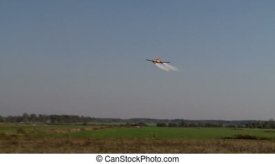 Twin-engined plane flying fast over airfield - View of...