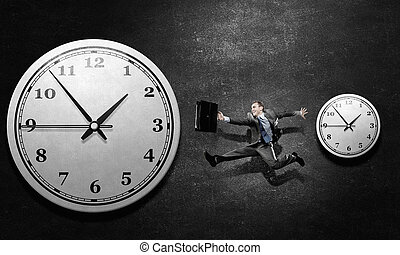 Catch up with time - Concept of time with funny businessman...