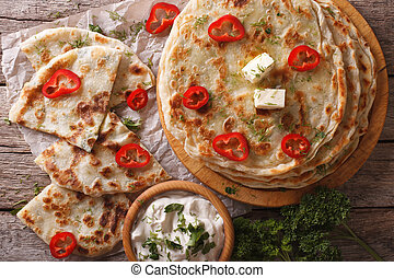 Indian paratha stuffed with potatoes close up. horizontal...