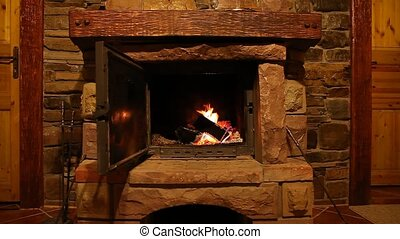 Wood logs fire burn in fireplace